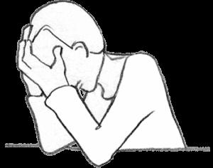Ein sitzender verzweifelter Mensch, der sein Gesicht in seinen Händen vergräbt als Zeichen für die Hoffnungslosigkeit bei Krebserkrankungen.