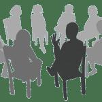Stuhlkreis mit Referent und Zuhörern