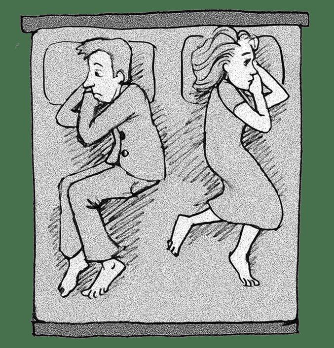 Mann und Frau im Bett voneinander abgewandt